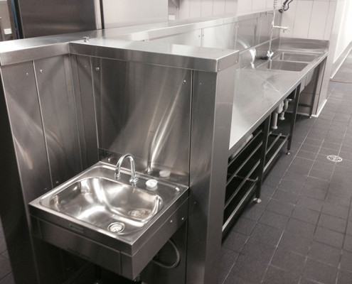 Stainless steel sink area in Subiaco Hotel's commercial kitchen