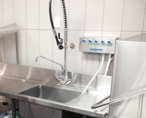 Stainless steel dishwashing area in Subiaco Hotel's commercial kitchen