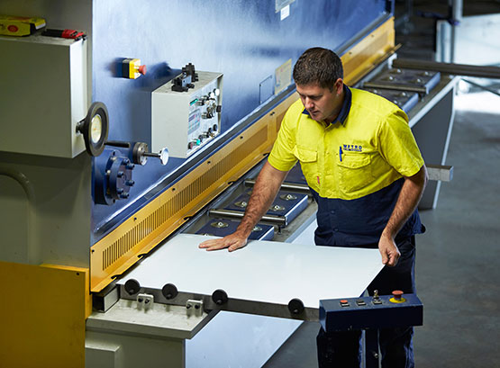 Metro Steel Services team member operating machinery