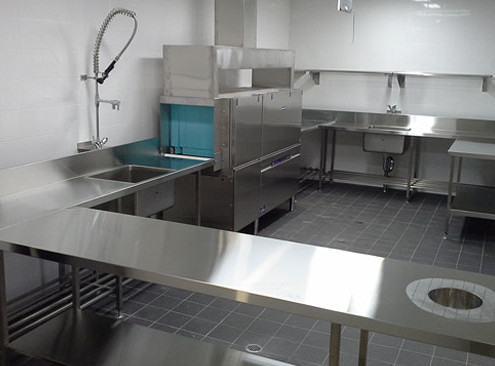 Stainless steel benchtops & sinks in a commercial kitchen