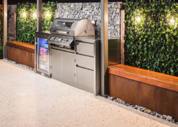 A custom outdoor entertaining area with a stainless steel barbecue