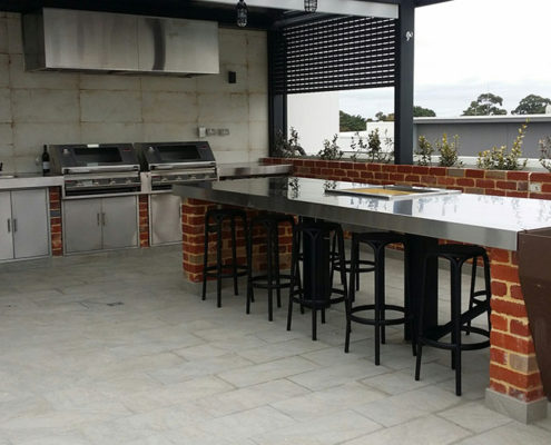 Outdoor barbecue area with stainless steel bench and sink